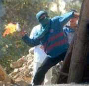 Intifadah: A Palestinian Throwing Molotov Coctails